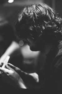 A boy rolls a joint