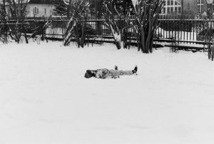 A child making a snow angel