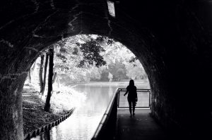 Girl runs through tunnel
