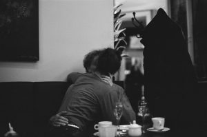 Couple making out wildly in cafe