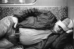 Fat German sleeping in subway