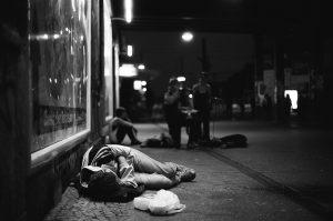 Teenager sleeping at Alexanderplatz