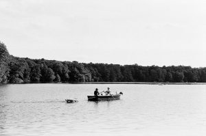 Friends make a boat trip with crocodiles on the Schlachtensee