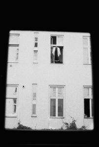A neighbor drying his clothes