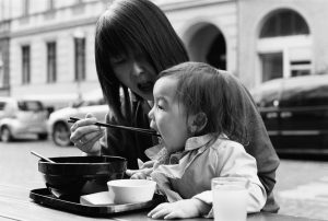 Mother feeds daughter