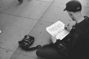 Traveller writing a sign for help